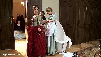 Three lesbos enjoy old costumes
