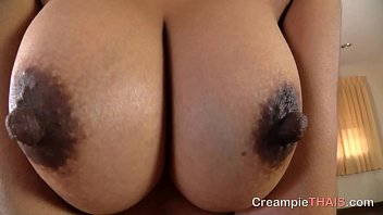 Sexy Thailand whore with huge tits lets a toursit creampie her pussy