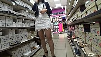 A girl with sexy thighs tries on different shoe...