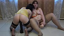 Lesbians in stockings masturbate with huge rubb...