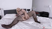 blonde mature BBW in sexy fishnet stockings and...