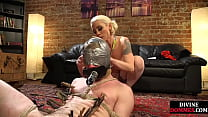 CBT domme uses ropes and clamps before strapon ...