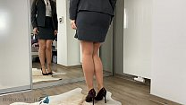 secretary dressing for office work and trying n...