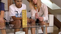 Homemade amateur girls playing Jenga at home wh...