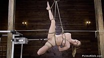 Solo brunette babe in rope suspension on her si...