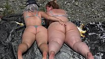 Hairy pussy licking in nature. Lesbians with bi...