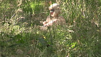 Voyeur looks out in nature as milf undresses an...