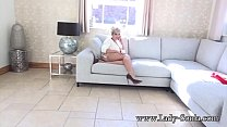 Busty mature masturbates while telling her frie...