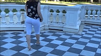 A lady with a big ass walks in the park