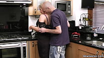 A man fucks a neighbor in the kitchen