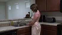 She is in the kitchen, while using the water to...