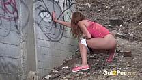 Public pissing - Desperate cute girl pisses out...