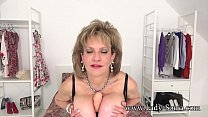 Mature blonde British babe wraps her big tits a...