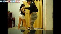 2 latinas doing a dance and showing their camel...