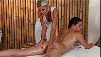 Oiled brunette gets pussy massage