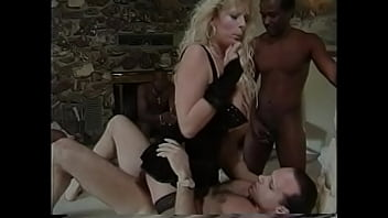 A sexy blonde slut with huge bazookas gets banged by two dudes