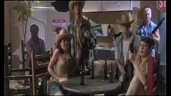 Sexy whore gets fucked with a strap on by her enemy in a bar