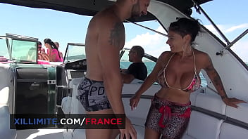 Busty mature brunette is interested by the young guys on the yacht