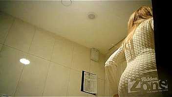 Beautiful blonde in toilet shaved pussy and anus closeups.
