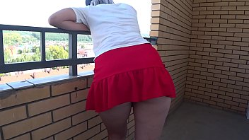 Sexy ass under the skirt. A girl in high-heeled shoes goes up the stairs and takes off her panties. Foot fetish and fetish with spying.