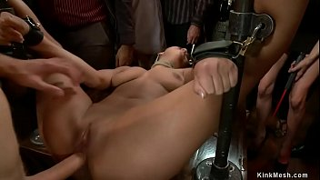 In public party mistress Princess Donna Dolore lets crowd spank hot tanned slave Evi Fox then makes her fuck big cock to Danny Wylde in bondage