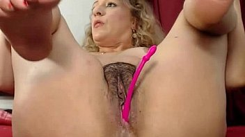 Blonde milf rubbing her hairy pussy