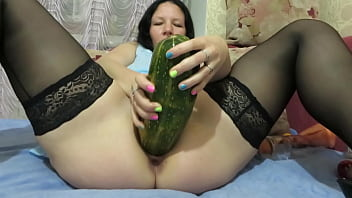 A mature BBW makes herself vaginal fisting, fucks with a big carrot and a huge zucchini, expands her cunt. Fancy insertions and gaping deep pussy.