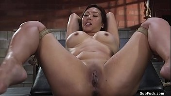 Big tits brunette Jasmine Ryder in standing bondage with spreader bamboo between her ankled and hands in box tie is tormented then fucked in doggy