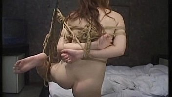 Asian babe tied and received hot wax on body