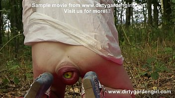 DGG insert apples in her large prolapse in public woods