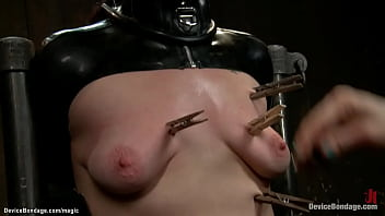 Bound in kneeling position in metal device Indian slave Siouxsie Q gets clamped then chained in doggy position oiled by lezdom Claire Adams