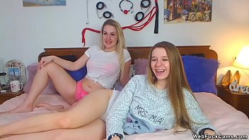 Blonde and brunette amateur lesbian teen camgirls stripping in bed then toying and fucking with strap on cock in live webcam show homemade