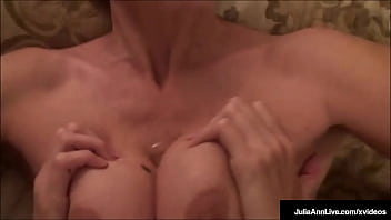Busty Booby Fucking Milf Julia Ann, takes her huggable hooters & titty fucks the cum, right out of his pulsating penis! Lucky mofo! Full Video & Julia Ann Live @ JuliaAnnLive.com!