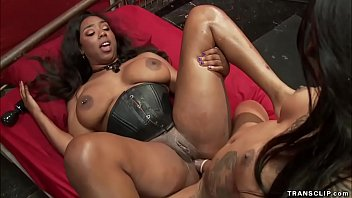 Big black cock ebony shemale dom Honey Foxxx in latex fucks throat to huge tits ebony slut Lisa Tiffian then fucks her pussy and asshole
