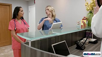 Blonde doctor shows her brunette intern around the hospital.She not really cheerful and the intern suggests to have some quality time right here to up her mood.She kisses the doctor sucks on her tits and licks her wet pussy.Then she facesits her