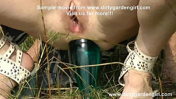DGG insert blue bottle in prolapse anal hole in forest