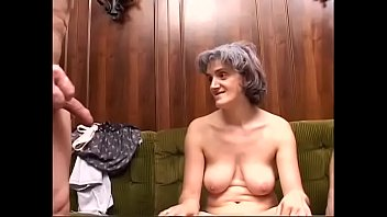 Slutty lady Patrizia takes on two huge cocks deeply inside all her holes on sofa