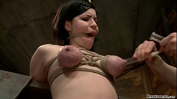Brunette slave Belle Noire in rope bondage on knees gets hard whipped then bent over and gagged gets pussy fucked with dildo and vibrator on stick in hands of lezdom Claire Adams