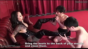 Two slaves lick the mistress Youko's boots