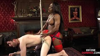 Black mistress makes slave suck her large clit