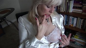 Big tits mature blonde Milf is posing and spreading her womanly thighs wide