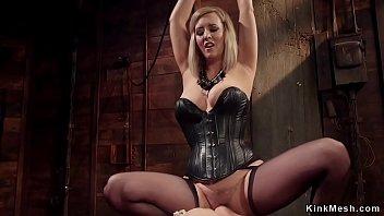 Hot ebony slave in rope bondage makes to face sitting by blonde lesbian mistress