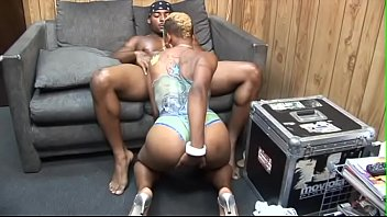 Marvellous blonde black beauty rides huge black cock on the small grey sofa