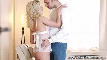 Young Courtesans - This blonde nubile looks simply gorgeous spreading her beautiful young pussy