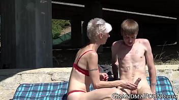 Kinky GILF sunbathing before blowjob
