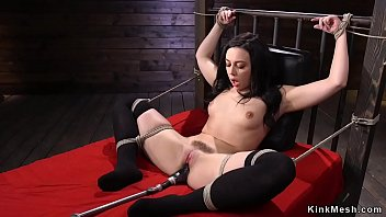 Dark haired solo babe in bondage in bed fuck machines in various positions