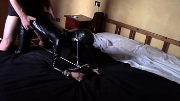 Laura on Heels model step sister tied up on the bed on latex and high heels. She has to deepthroat a massive cock with a ring gag and fucked till orgasm with creampie