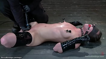 Blindfolded and gagged with limbs taped brunette slave Casey Calvert gets pussy vibrated then in pile driver double penetration finger fucked by masters The Pope and Orlando