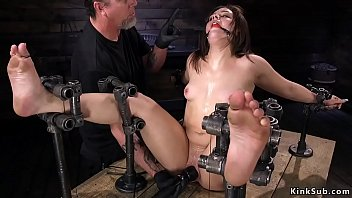 Gagged small tits brunette slave Kimber Woods with locked wrists and ankles and spreaded legs gets pussy vibed
