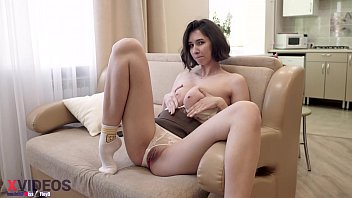 Tall girl masturbates on the sofa alone at home with a toy